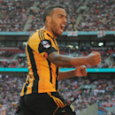 Hull City's Tom Huddlestone celebrates after scoring against Sheffield United during their English FA Cup semifinal soccer match between Hull City and Sheffield United at Wembley Stadium, London, England, Sunday, April 13, 2014