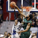Wright State forward Jerran Young, right, blocks a shot by Georgetown forward Aaron Bowen during the first half of an NCAA college basketball game Wednesday, Nov. 13, 2013, in Washington. (AP Photo/Alex Brandon)