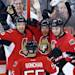 Ottawa Senators Daniel Alfredsson (11) celebrates with teammates Milan Michalek (9), Sergei Gonchar (55) and Mika Zibanejad (93) in the third period of game four of the Eastern Conference Stanley Cup semi-final NHL hockey action on Sunday May 19, 2013 in Ottawa