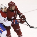 Montreal Canadiens' Mike Weaver (43) is called for slashing as he breaks the stick of Phoenix Coyotes' David Moss (18) during the third period of an NHL hockey game Thursday, March 6, 2014, in Glendale, Ariz. The Coyotes defeated the Canadiens 5-2 The As