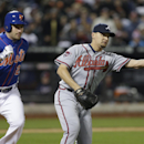 Atlanta Braves relief pitcher Luis Avilan, right, throws out New York Mets' Daniel Murphy at first base during the eighth inning of a baseball game on Friday, April 18, 2014, in New York The Associated Press