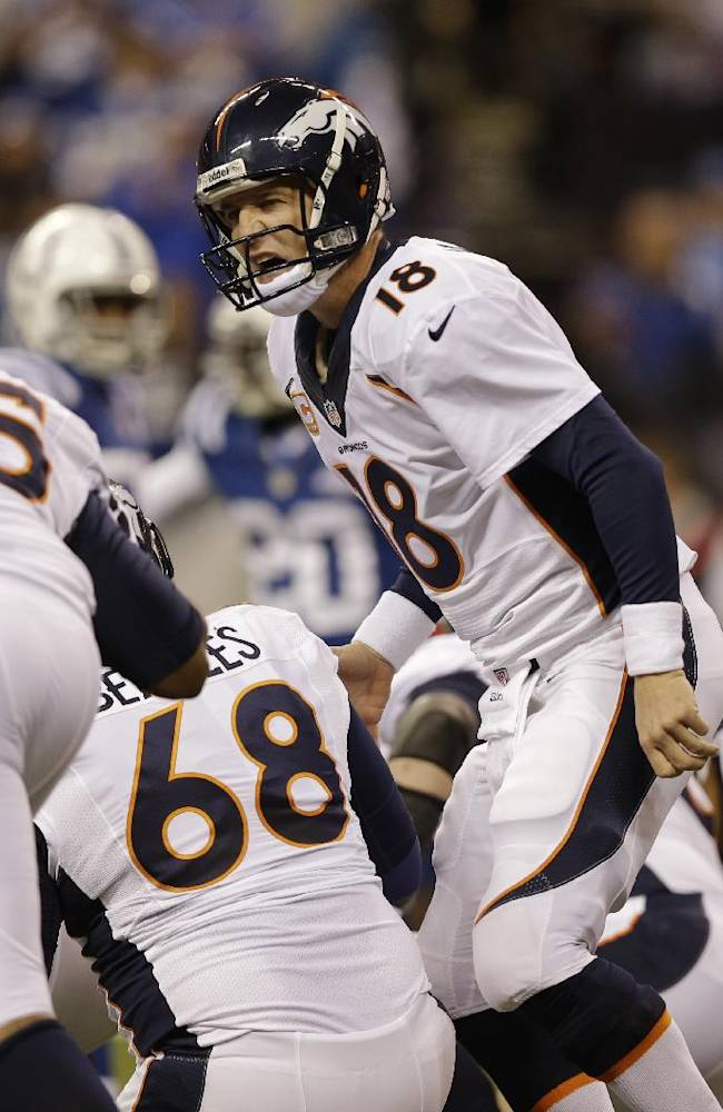 Denver Broncos quarterback Peyton Manning (18) calls a play before a snap during the first half of an NFL football game against the Indianapolis Colts, Sunday, Oct. 20, 2013, in Indianapolis