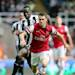 Arsenal's Aaron Ramsey, right, vies for the ball with Newcastle United's Cheick Tiote, left, during their English Premier League soccer match at St James' Park, Newcastle, England, Sunday, May 19, 2013. (AP Photo/Scott Heppell)