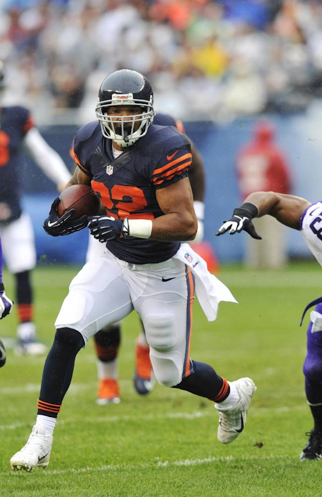 Chicago Bears running back Matt Forte (22) rushes past Minnesota Vikings defensive end Brian Robison (96) and safety Jamarca Sanford (33) during the first half of an NFL football game on Sunday, Sept. 15, 2013, in Chicago