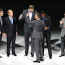 Troy Aikman, Roger Staubach, Dirk Nowitzki, Rolando Blackman and Michael Young congratulate Mike Modano as Modano's No. 9 Dallas Stars jersey is retired, before the NHL hockey game between the Stars and the Minnesota Wild in Dallas on Saturday, March 8, 2