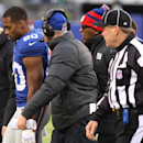 New York Giants wide receiver Victor Cruz (80) walks off the field with head coach Tom Coughlin, center left, during the second half of an NFL football game against the Seattle Seahawks, Sunday, Dec. 15, 2013, in East Rutherford, N.J. (AP Photo/Peter Morgan)