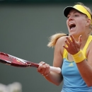Germany's Angelique Kerber reacts as she plays Svetlana Kuznetsova, of Russia, during their fourth round match of the French Open tennis tournament at the Roland Garros stadium Sunday, June 2, 2013 in Paris. (AP Photo/Christophe Ena)