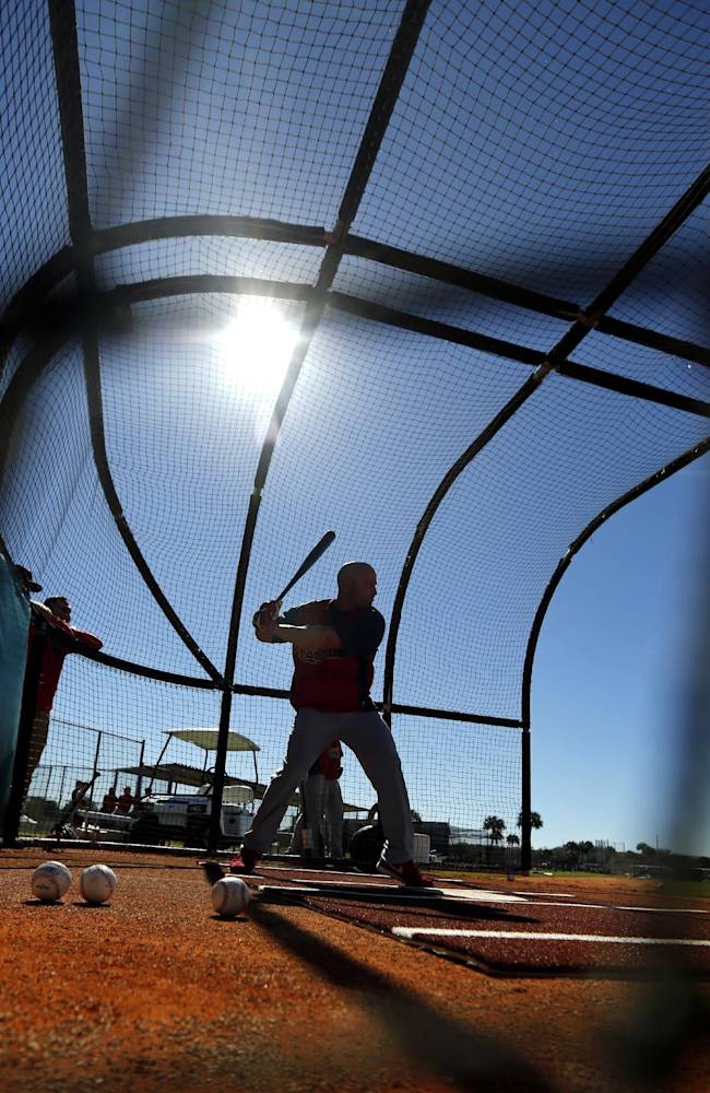 St. Louis Cardinals' Matt Holliday takes batting practice during spring training baseball Sunday, Feb. 16, 2014, in Jupiter, Fla