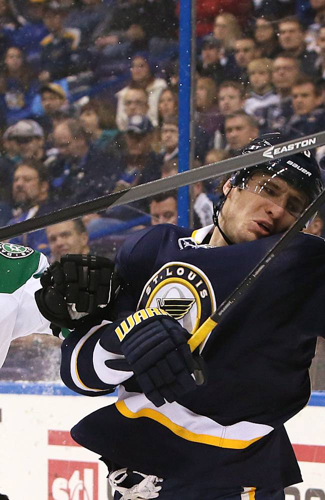 St. Louis Blues left wing Alexander Steen (right) battles against Dallas Stars defenseman Sergei Gonchar in first period action during a game between the St. Louis Blues and the Dallas Stars on Saturday, Nov. 23, 2013, in St. Louis