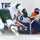 Minnesota Wild's Mikko Koivu (9) and Edmonton Oilers' Mark Fayne (5) collide during the second period of an NHL hockey game Tuesday, Jan. 27, 2015, in Edmonton, Alberta The Associated Press