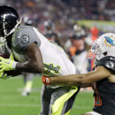 Pittsburgh Steelers' Antonio Brown is tackled by Miami Dolphins' Brent Grimes during the first half of the NFL Football Pro Bowl Sunday, Jan. 25, 2015, in Glendale, Ariz The Associated Press