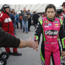 Danica Patrick shakes the hand of a fan as she heads to her hauler after qualifying for Sunday's Sprint Cup Series auto race at Martinsville Speedway in Martinsville, Va., Friday, Oct. 24, 2014. (AP Photo/Steve Helber)