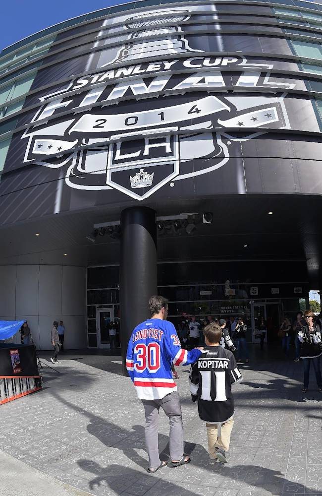 Chad Blocker, left, and Blake Arbuckle walk outside Staples Center prior to Game 1 of the NHL hockey Stanley Cup Finals, Wednesday, June 4, 2014, in Los Angeles