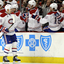 Montreal Canadiens defenseman Sergei Gonchar (55) celebrates with teammates after scoring his goal against the Chicago Blackhawks during the second period of an NHL hockey game in Chicago, Friday, Dec. 5, 2014 The Associated Press
