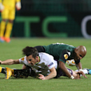 Krasnodar's Ari, right, fights with Everton's Leighton Baines during the Europa League Group H soccer match between Krasnodar and Everton in Krasnodar, Russia, Thursday, Oct. 2, 2014