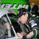 Kyle Busch looks at his race car during practice for Sunday's NASCAR Sprint Cup series auto race, Friday, Sept. 27, 2013, at Dover International Speedway in Dover, Del. (AP Photo/Nick Wass)