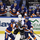 New York Islanders right wing Michael Grabner (40) and left wing Nikolay Kulemin (86) put the squeeze on Pittsburgh Penguins center Sidney Crosby (87) during the first period of an NHL hockey game at Nassau Coliseum on Friday, Jan. 16, 2015, in Uniondale,
