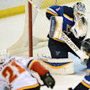 St. Louis Blues' goalie Brian Elliott (1) blocks a shot by Calgary Flames' Mason Raymond (21) as the Blues' Kevin Shattenkirk defends during the second period of an NHL hockey game, Saturday, Oct. 11, 2014, in St. Louis The Associated Press