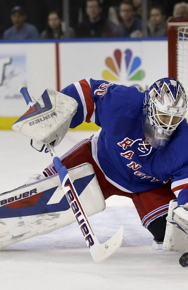 New York Rangers goalie Henrik Lundqvist makes a save during the first period in Game 5 of an NHL hockey first-round playoff series against the Philadelphia Flyers, Sunday, April 27, 2014, in New York