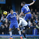 Chelsea's Gary Cahill, right, jumps for the ball during an English Premier League soccer match against Everton at the Stamford Bridge ground in London, Saturday, Feb. 22, 2014. Chelsea won the match 1-0