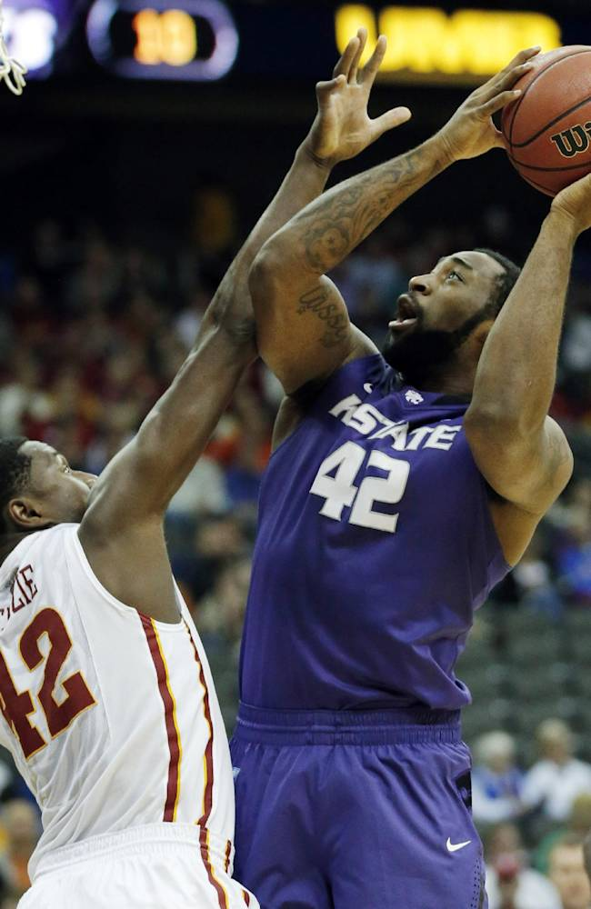 Kansas State forward Thomas Gipson, right, is fouled by Iowa State forward Daniel Edozie, left, during the first half of an NCAA college basketball game in the quarterfinals of the Big 12 Conference men's tournament in Kansas City, Mo., Thursday, March 13, 2014
