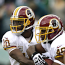 Washington Redskins quarterback Robert Griffin III hands the ball off to running back Alfred Morris during the first half of an NFL football game against the Philadelphia Eagles in Philadelphia, Sunday, Nov. 17, 2013 The Associated Press