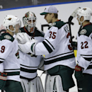 Minnesota Wild goalie Niklas Backstrom, second from left, is congratulated by center Mikko Koivu (9) goalie Darcy Kuemper (35) and right wing Nino Niederreiter (22) after the Wild defeated the Florida Panthers 4-1 in an NHL hockey game, Monday, Nov. 24, 2