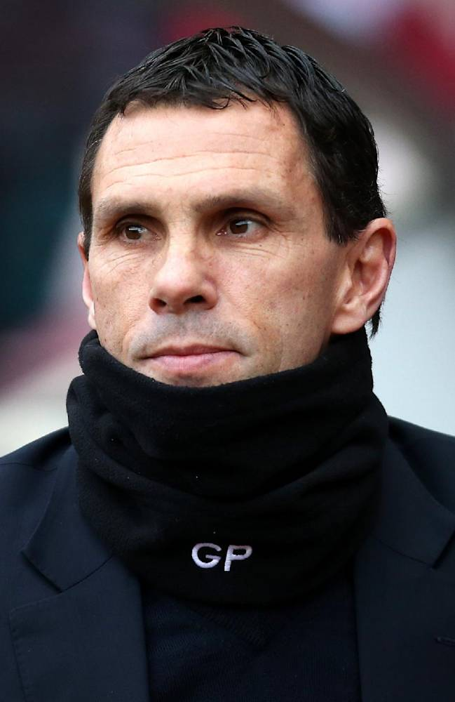 Sunderland's manager Gus Poyet looks on ahead of their English FA Cup third round soccer match against Carlisle United at the Stadium of Light, Sunderland, England, Sunday, Jan. 5, 2014