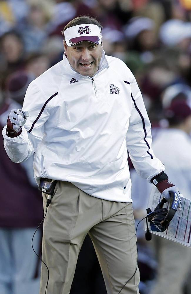 Mississippi State head coach Dan Mullen congratulates players after a score against Rice in the first quarter of the Liberty Bowl NCAA college football game on Tuesday, Dec. 31, 2013, in Memphis, Tenn