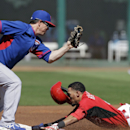 Nate Schierholtz's homer powers Cubs past Reds 9-0 The Associated Press