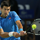 Novak Djokovic of Serbia returns the ball to Roger Federer of Switzerland during the final match of the Dubai Duty Free Tennis Championships in Dubai, United Arab Emirates, Saturday, Feb. 28, 2015. (AP Photo/Kamran Jebreili)