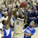 Pittsburgh's Dante Taylor (11) shoots between Seton Hall's Kevin Johnson, left, and Brandon Mobley (2) in the first half of the NCAA college basketball game on Monday, Feb. 4, 2013 in Pittsburgh. (AP Photo/Keith Srakocic)