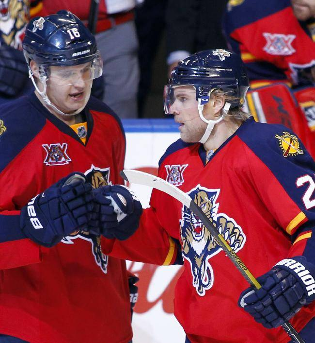 Florida Panthers left wing Sean Bergenheim (20) celebrates with teammate Aleksander Barkov (16) after scoring a goal during the third period of an NHL hockey game against the Montreal Canadiens in Sunrise, Fla., Sunday, Dec. 29, 2013