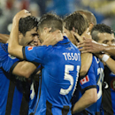 Players from the Montreal Impact celebrate a goal by teammate Marco Di Vaio against the Chicago Fire during the second half of an MLS soccer game Saturday, Aug. 16, 2014, in Montreal The Associated Press