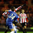 Sunderland's Jozy Altidore, rear, vies for the ball with Chelsea's Gary Cahill during their English Premier League soccer match at the Stadium of Light, Sunderland, England, Wednesday, Dec. 4, 2013