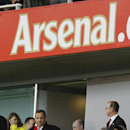 New Jersey Gov. Chris Christie, center left, wearing an Arsenal scarf, walks to his seat after the half time break during the English Premier League soccer match during the English Premier League soccer match between Arsenal and Aston Villa at the Emirate
