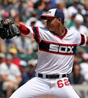Chicago White Sox starting pitcher Jose Quintana delivers to the Atlanta Braves in the first inning of a baseball game in Chicago, Sunday, July 21, 2013. (AP Photo/Charles Cherney)