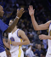 Golden State Warriors' David Lee, right, is congratulated by Marreese Speights (5) during a timeout in the second half of an NBA basketball game against the Houston Rockets Thursday, Feb. 20, 2014, in Oakland, Calif. (AP Photo/Ben Margot)
