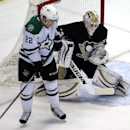 Dallas Stars' Colton Sceviour (22) gets out of the way of a shot in front of Pittsburgh Penguins goalie Jeff Zatkoff (37) during the first period of an NHL hockey game in Pittsburgh, Tuesday, March 18, 2014. Zatkoff blocked the shot. The Penguins won 5-1