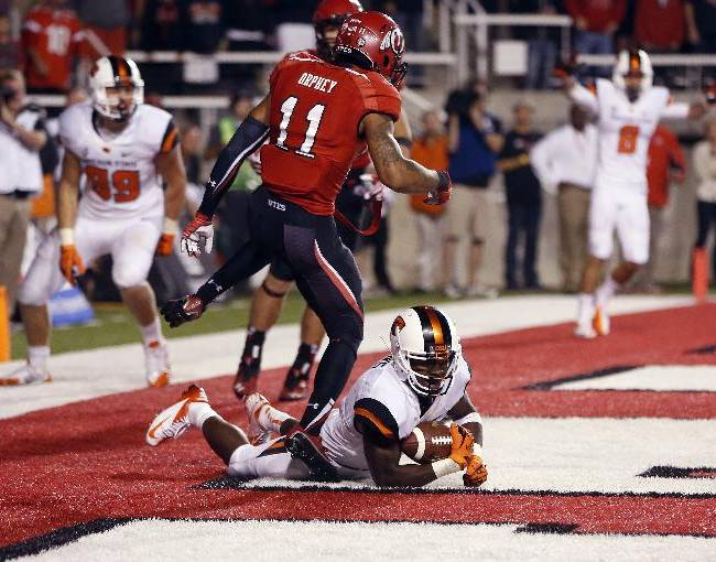 Oregon State wide receiver Brandin Cooks (7) makes a catch for the winning touchdown against Utah in overtime during an NCAA college football game in Salt Lake City, Utah, Saturday, Sept. 14, 2013. Oregon State won 51-48