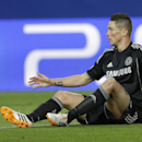 Chelsea's Fernando Torres gestures with his hands as he sits on the ground during the Champions League semifinal first leg soccer match between Atletico Madrid and Chelsea at the Vicente Calderon stadium in Madrid, Spain, Tuesday, April 22, 2014