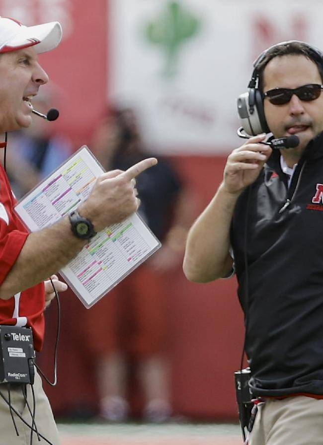 Nebraska head coach Bo Pelini, left, calls instructions with defensive coordinator John Papuchis looking on, in the first half of an NCAA college football game against UCLA in Lincoln, Neb., Saturday, Sept. 14, 2013. UCLA won 41-21