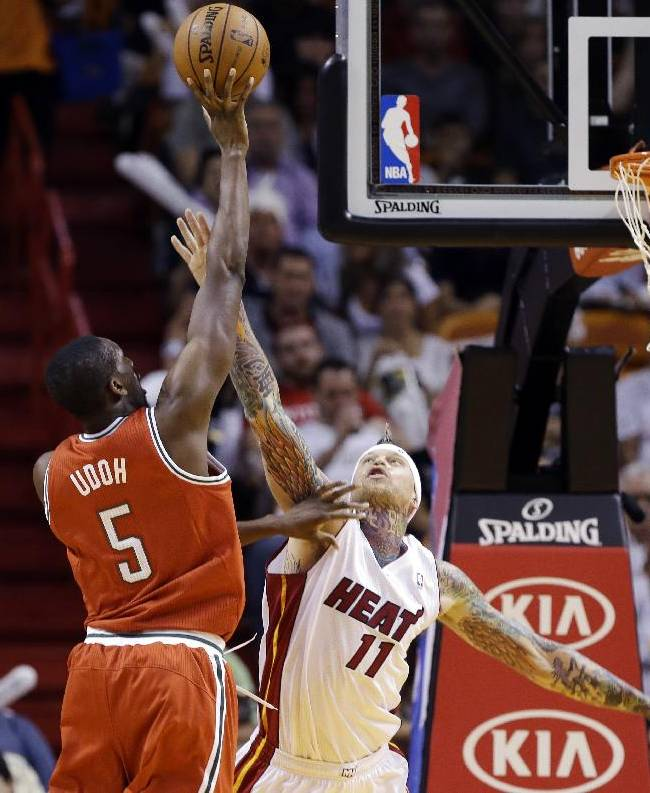 Milwaukee Bucks' Ekpe Udoh (5) shoots as Miami Heat's Chris Andersen (11) defends during the first half of an NBA basketball game Tuesday, Nov. 12, 2013, in Miami