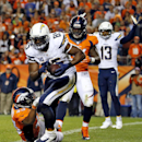 San Diego Chargers tight end Antonio Gates (85) scores a touchdown as Denver Broncos strong safety T.J. Ward, left, defends during the second half of an NFL football game, Thursday, Oct. 23, 2014, in Denver The Associated Press