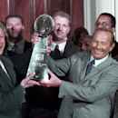 In this June 16, 1998 file photo, President Clinton, left, and Denver Broncos owner Pat Bowlen hold the Vince Lombardi Trophy during a ceremony at the White House where the president honored the Super Bowl XXXII champions. Super Bowl Most Valuable Player