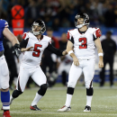 Atlanta Falcons kicker Matt Bryant (3) watches his game-winning field goal with holder Matt Bosher (5) during overtime in an NFL football game on Sunday, Dec. 1, 2013, in Toronto. Atlanta won 34-31 The Associated Press
