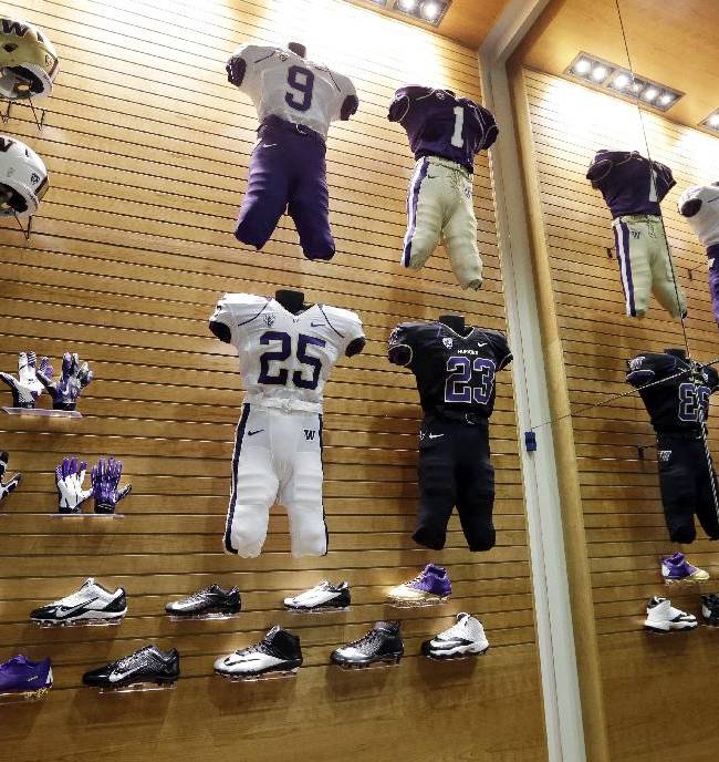 In this Aug. 28, 2013 file photo, uniforms, helmets, gloves and shoes are displayed in a