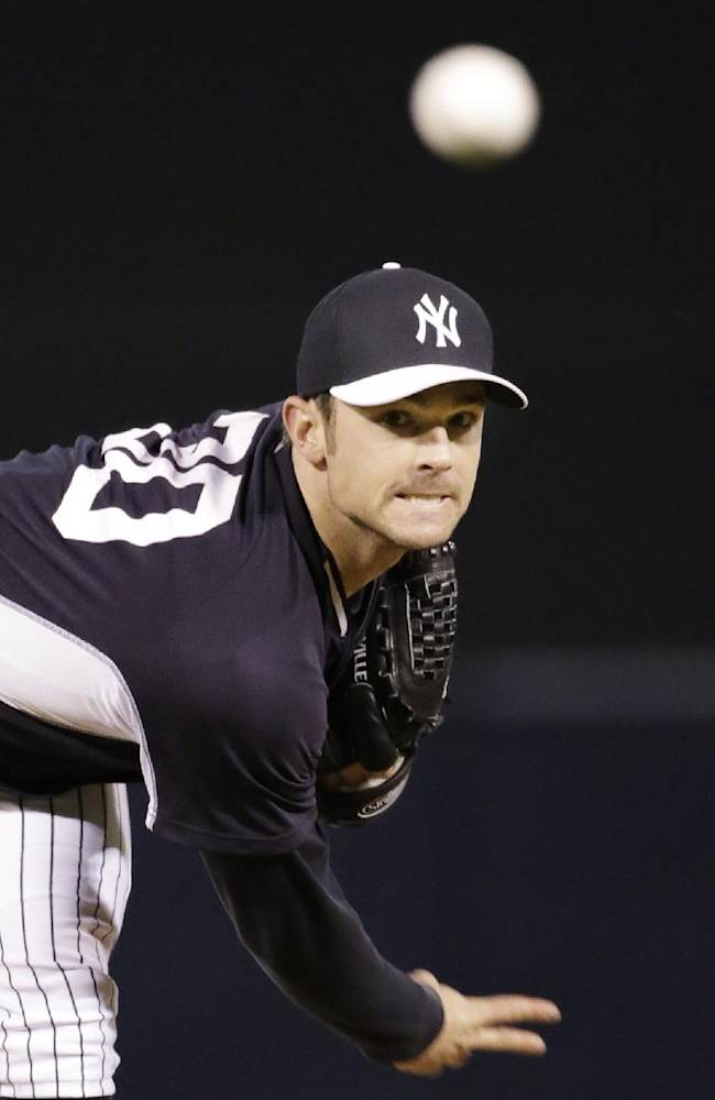 New York Yankees relief pitcher David Robertson warms up in the fourth inning of a spring exhibition baseball game against the Philadelphia Phillies in Tampa, Fla., Tuesday, March 25, 2014