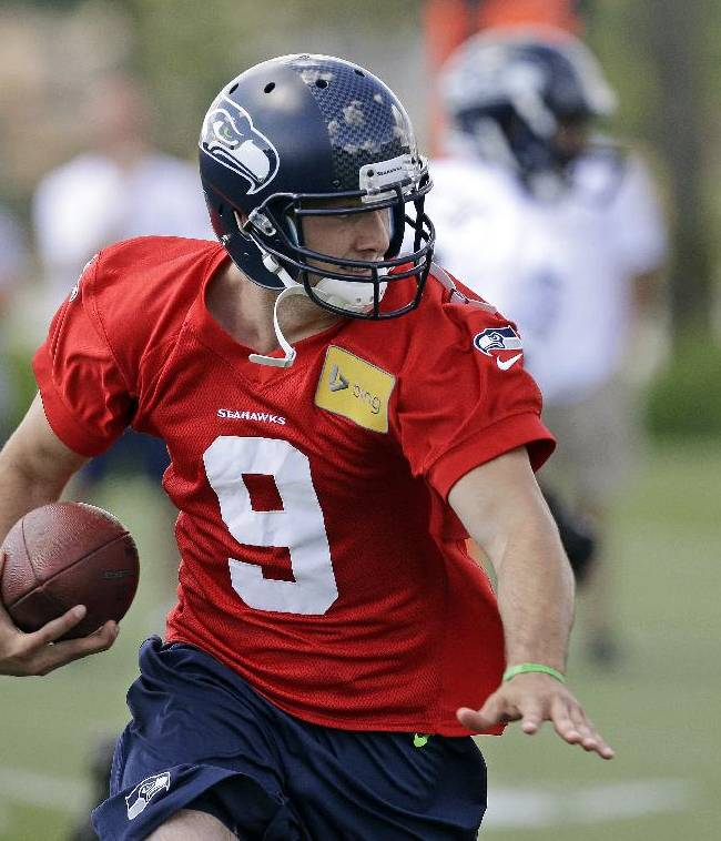 Seattle Seahawks quarterback Zach Zuli runs with the ball during NFL football rookie minicamp Saturday, May 17, 2014, in Renton, Wash