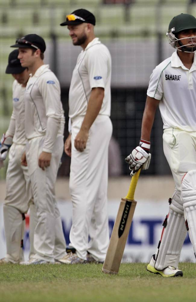Bangladesh's Marshall Ayub, right, walks back to the pavilion after his dismissal by New Zealand's Neil Wagner on the first day of the second cricket test match between them in Dhaka, Bangladesh, Monday, Oct. 21, 2013